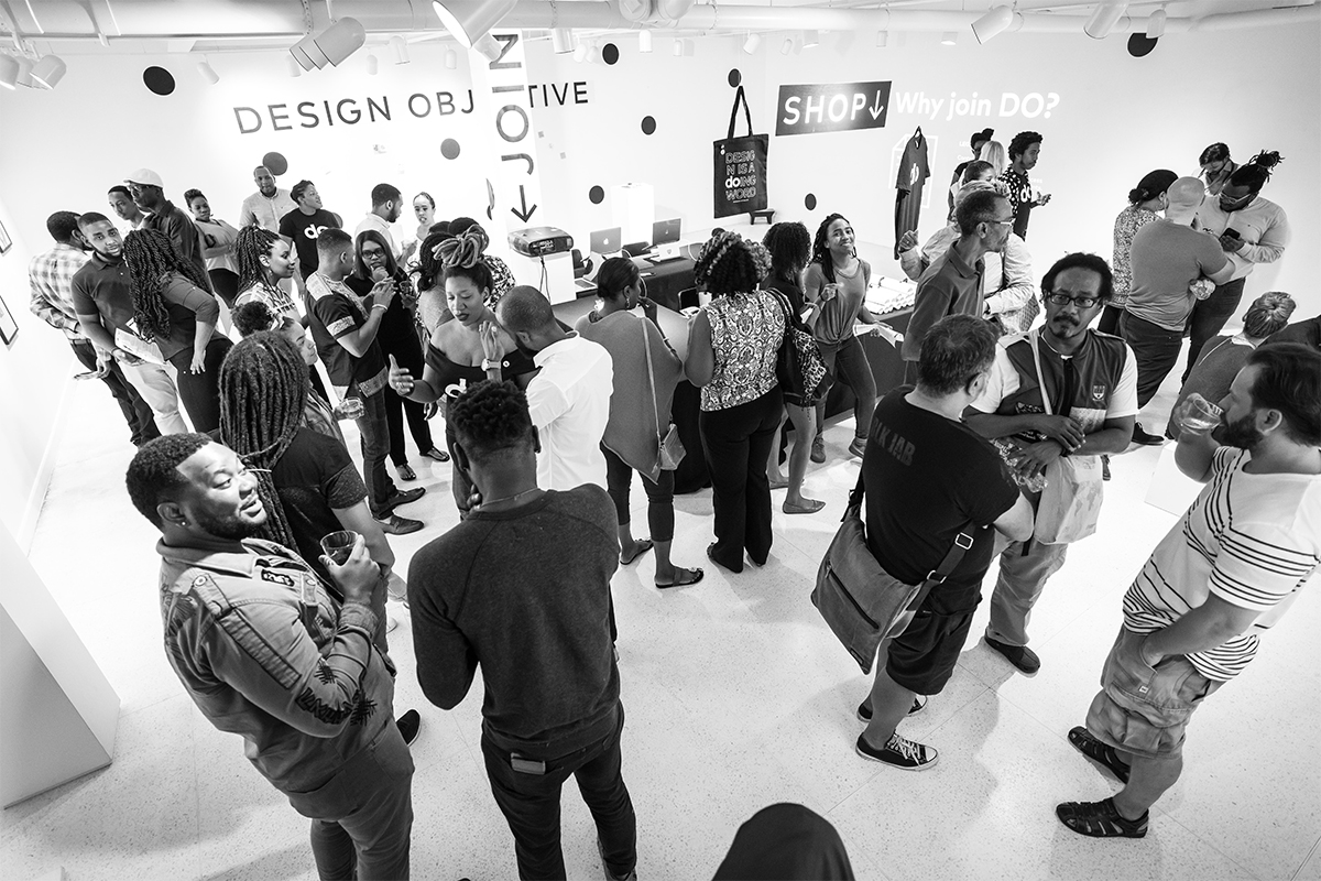 A Photo of a crowd of people at a Design Objective Event